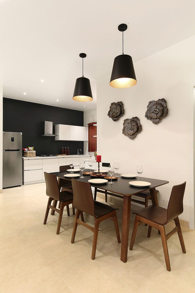 spacious dining area featuring a thoughtful mix of materials and textures