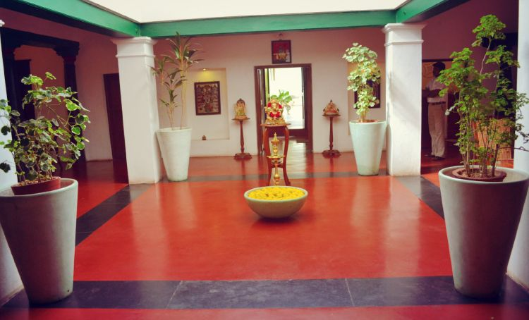 red oxide flooring-courtyard-golden idols-potted plants