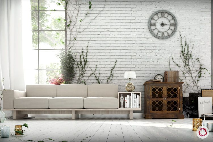 Interior design styles-white exposed brick wall-white couch-table lamp
