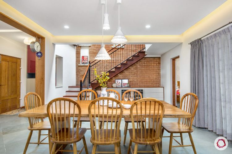 dining table-wooden furniture-staircase-exposed brick wall