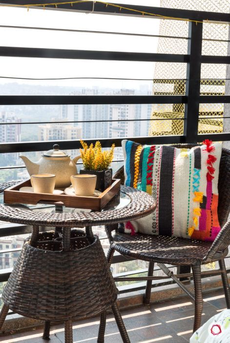 balcony design-rattan-furniture-chairs-table-colourful-pillow