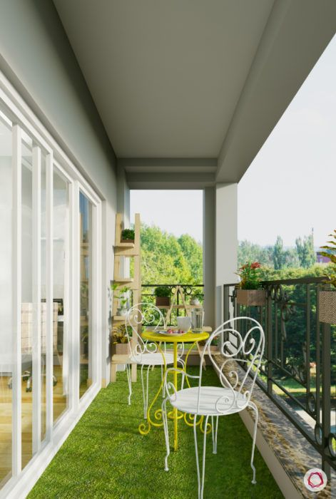 balcony-yellow-white-chairs-table-faux-grass