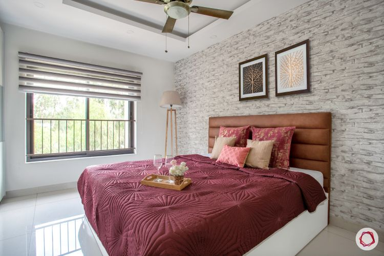 blinds-neutral-strip-bedroom-brown-headboard-brick-wall-maroon-sheet