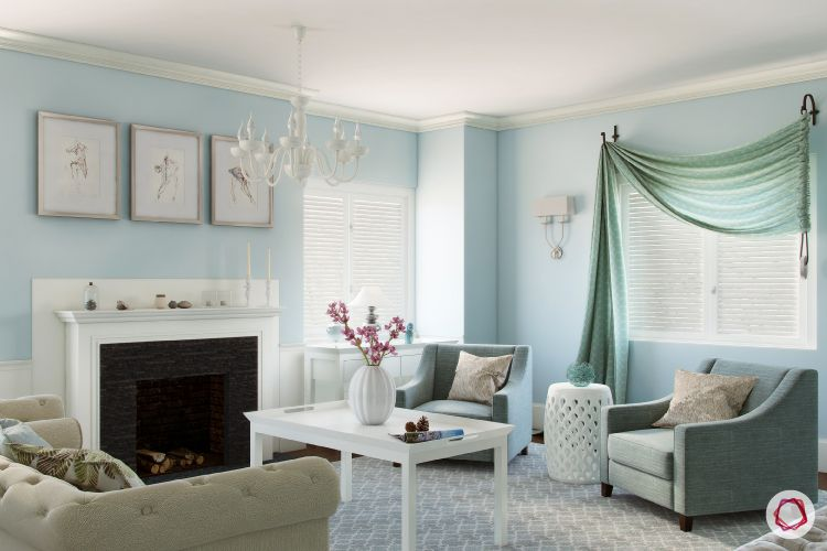 blinds-living-room-green-pastel-blue-wall-fireplace-soft-sofas-coffee-table