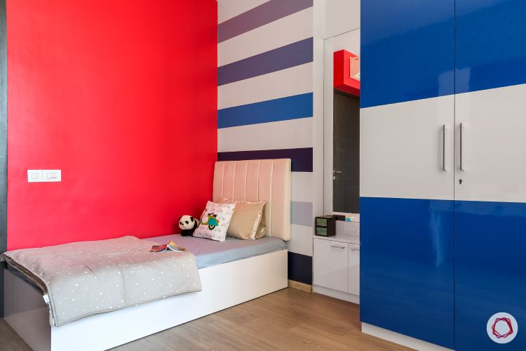 red accent wall-son bedroom-blue and white cabinets
