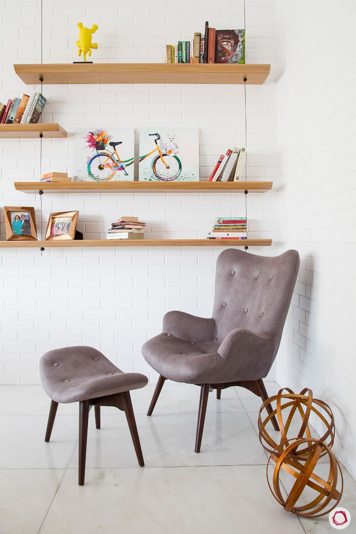 Alia Bhatt-reading corner-wooden shelves-exposed brick wall-accent chair