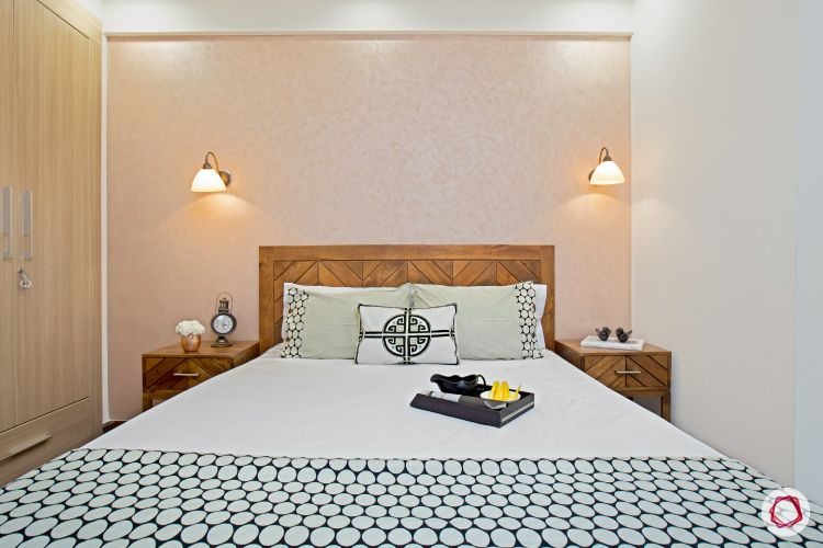 top interior designer guest room with beige coloured wall and chevon headboard