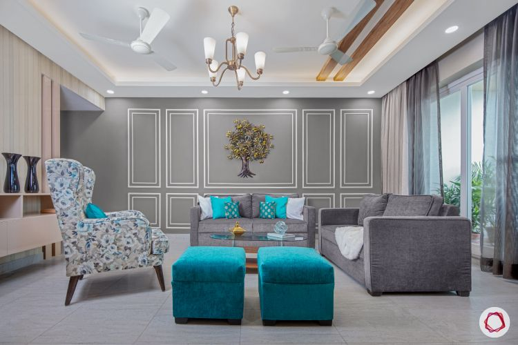 3bhk flat_living room-grey-wall-white-trims-blue-ottomans-chairs-sofas
