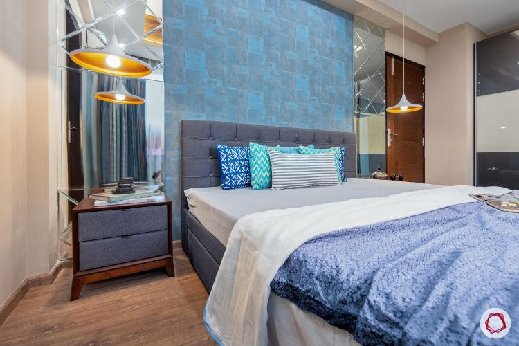 master-bedroom-blue-wall-mirror-panel-light-fixture-bed-sidetable-wooden-floor