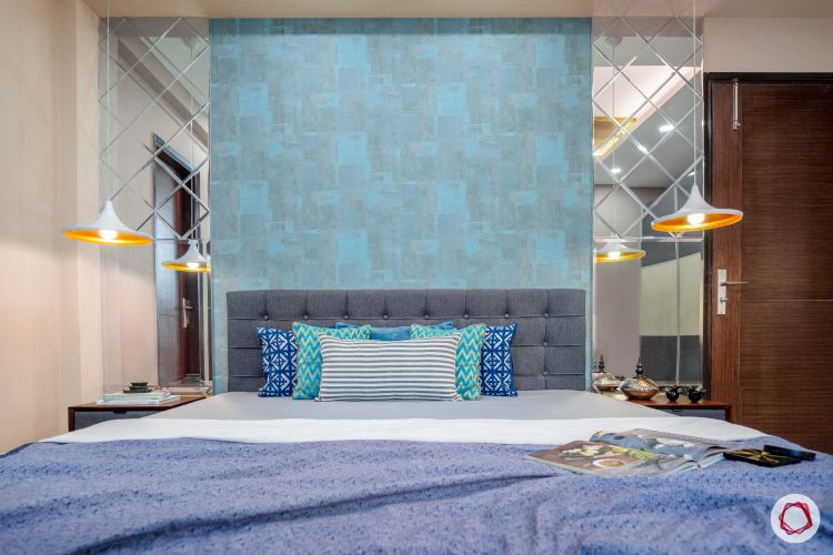 master-bedroom-blue-wall-mirror-panel-light-fixture-bed