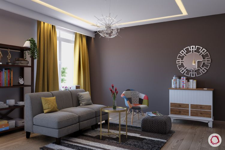 paint or wallpaper indian walls-grey sofa-yellow curtains-bookshelf