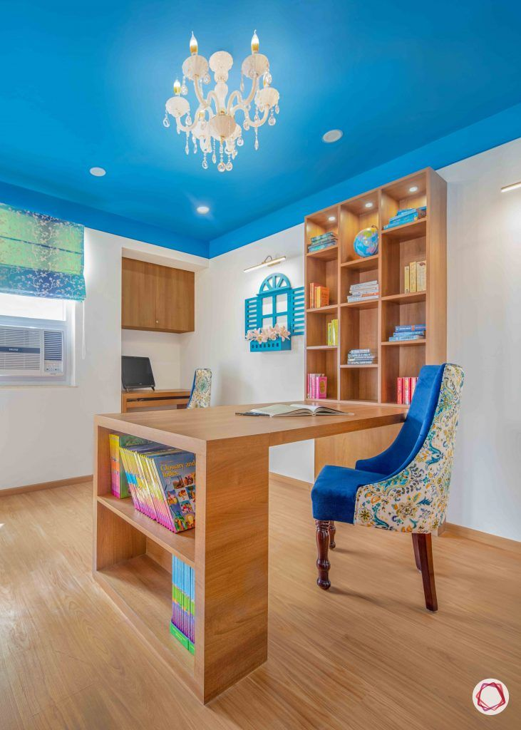 blue ceiling-blue chair-wooden study furniture-chandelier