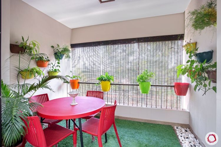 balcony design red table-planters-colourful-black-railing