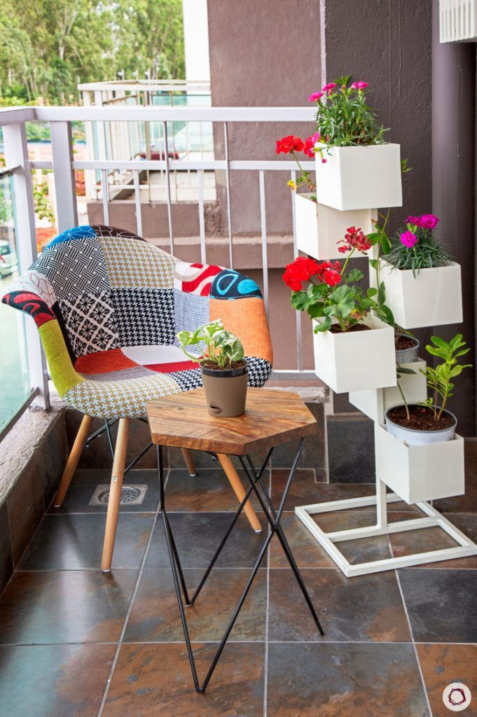 Balcony Design-patchwork-chair-plants-coffee-table-planters