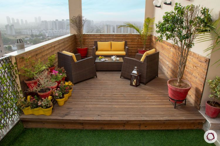 Balcony Design-high-platform-yellow-planters-red-yellow