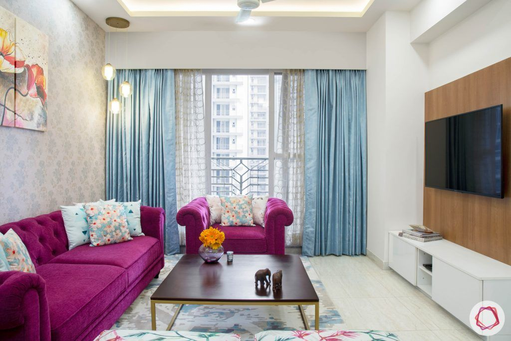 Cleo county noida_living room with sheer drapes and ample lighting