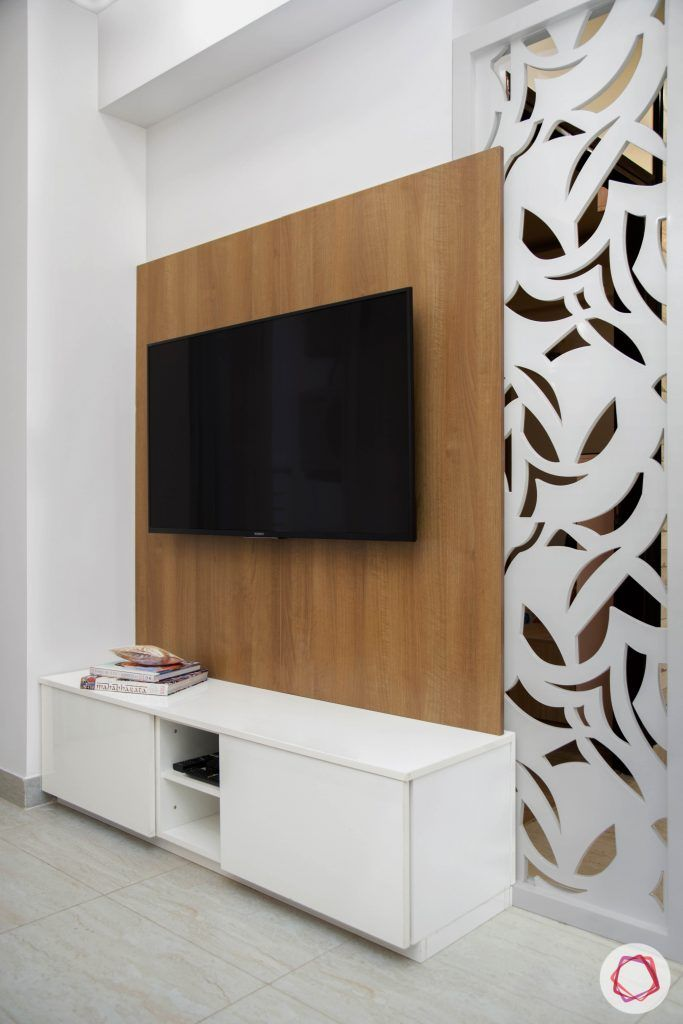 Cleo county noida_living room with laminate tv unit and jaali divider