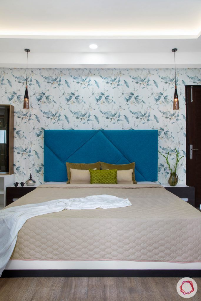 Cleo county noida_master bedroom with blue headboard on white bed