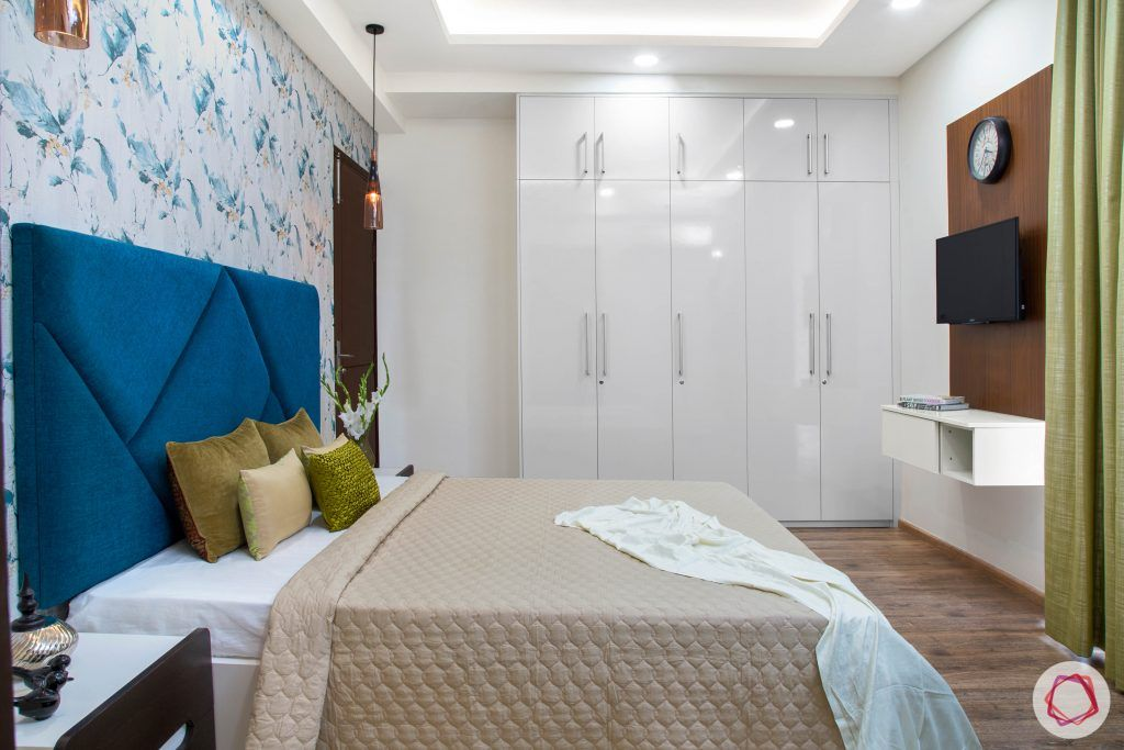 Cleo county noida_master bedroom with white wardrobes