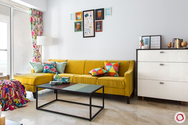 livspacehomes-low budget house-living room-colourful-pouf-yellow-sofa-artsy