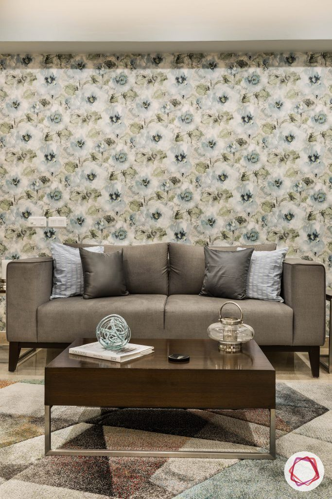 flat interior design-floral-living room-grey sofa-floral wallpaper-coffee table-accent patterned rug