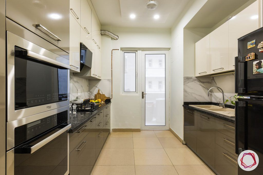 flat interior design-parallel kitchen-white overhead cabinets- brown lower cabinets-false ceiling