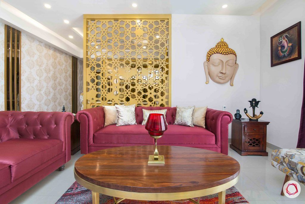 livspace interior-living-room-gold-buddha-silk-sofas-coffee-table