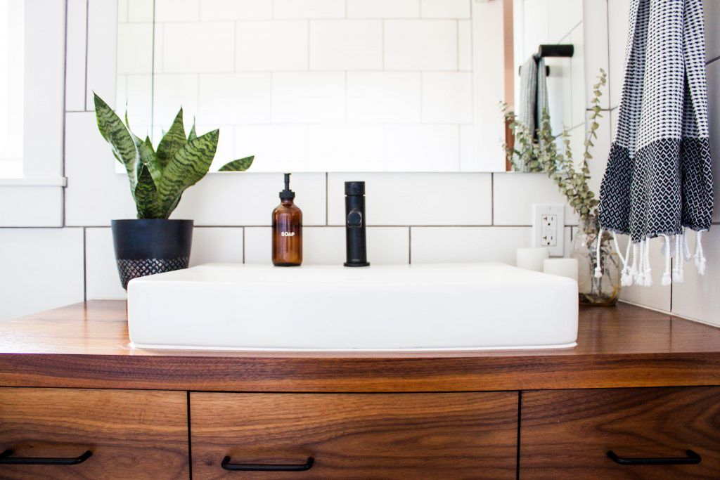 housekeeping-checklist-bathroom-fresh-towels-potted-plant-wooden-cabinet-mirror