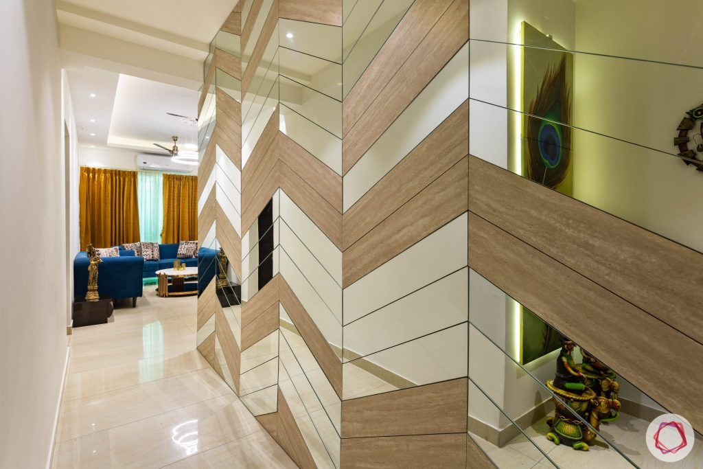 3 bhk flat-home entrance-foyer-wall paneling-wooden and mirror wall panel-chevron pattern