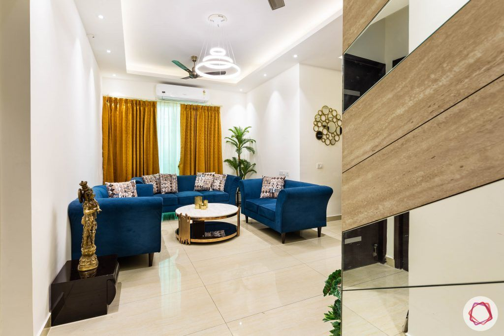 3 bhk flat-living room-entrance-blue sofas-yellow curtains