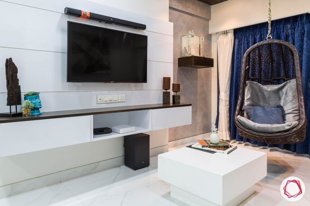 house-renovation-living-room-tv-panel-pooja-textured-wall-swing-coffee-table