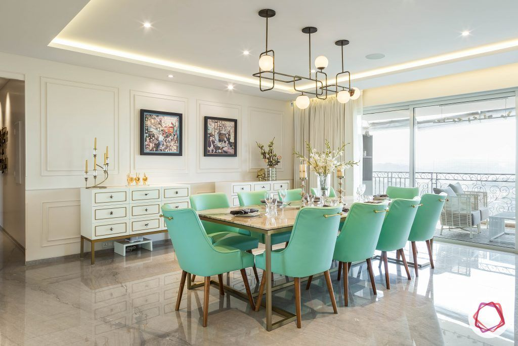 livspace interior-dining-room-mint-chairs-marble-top-industrial-light