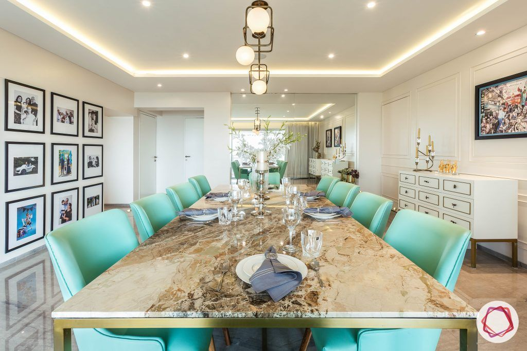 4bhk house plan-living room furniture-marble tabletop-10-seater dining set-green dining chairs-gallery wall designs-wall moulding designs