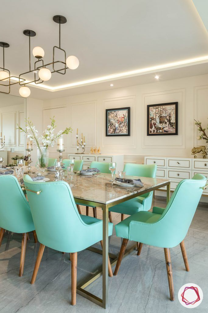 4bhk house plan-living room furniture-marble table top-green dining chairs-wall moulding designs-hite consoles-marble flooring