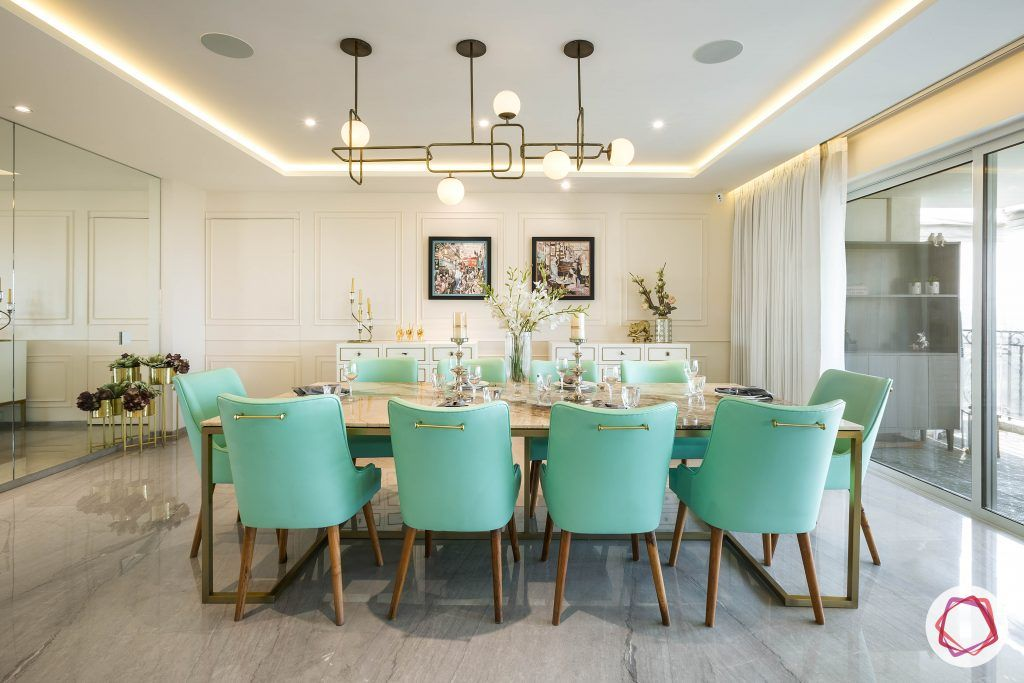 4bhk house plan-living room furniture-marble tabletop-10-seater dining set-green dining chairs-wall moulding designs-modern chandelier designs-marble-flooring