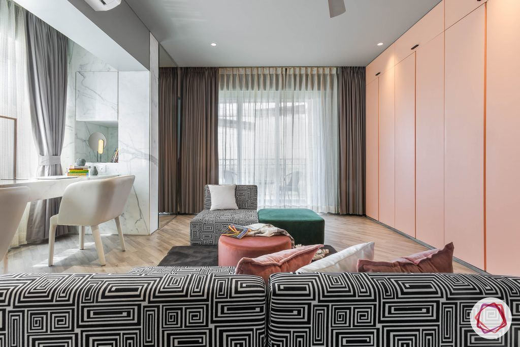 4bhk house plan-master bedroom designs-fabric loungers-monochrome couch designs-marble wall designs