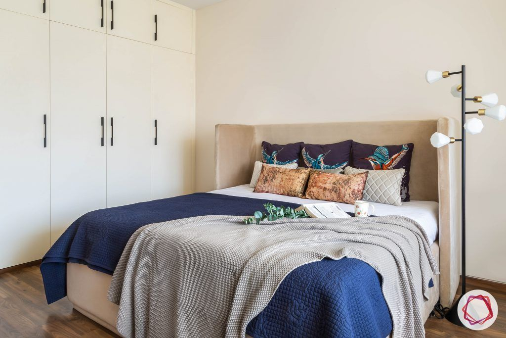 4bhk house plan-guest room designs-upholstered bed-wingback bed-wooden flooring-white wardrobes