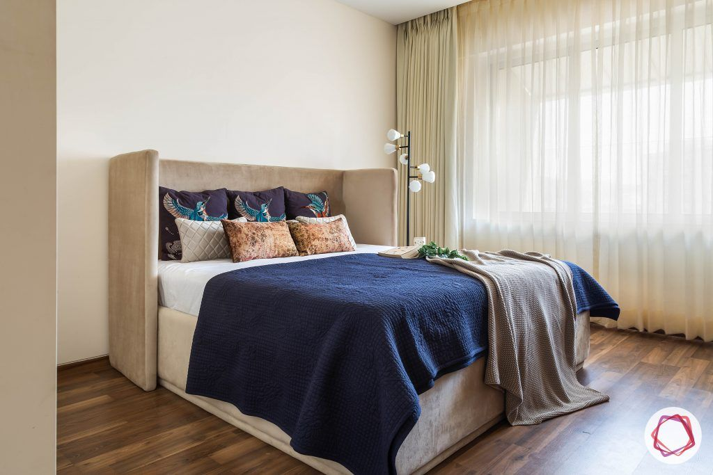 4bhk house plan-guest room designs-upholstered bed-wooden flooring-sheer curtains