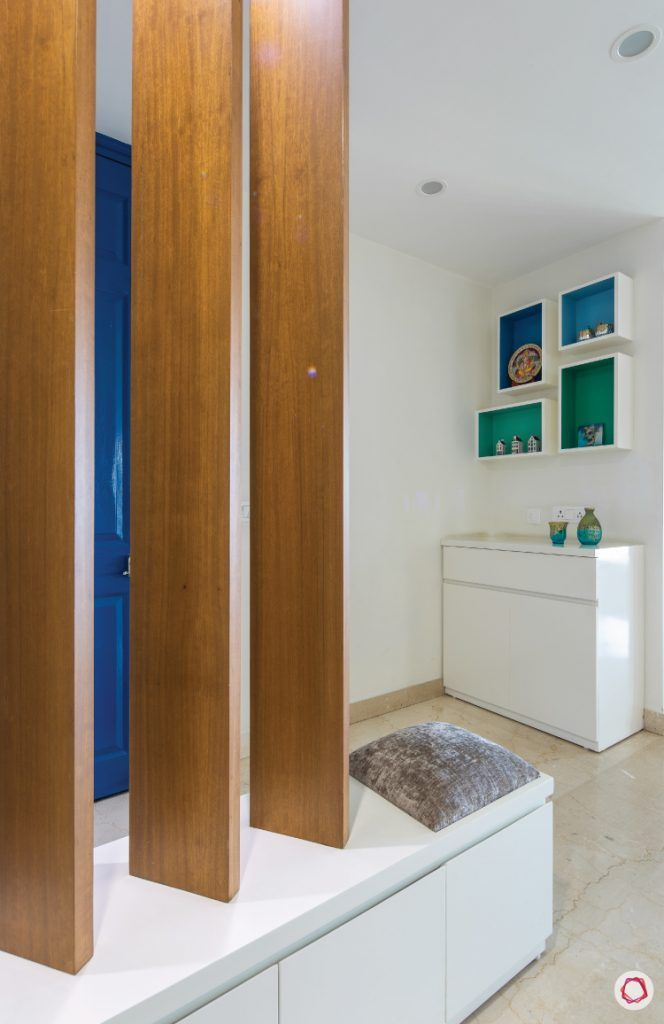 flat-in-faridabad-entrance-foyer-wooden-rafters-storage-cabinet-shelves-white-seating