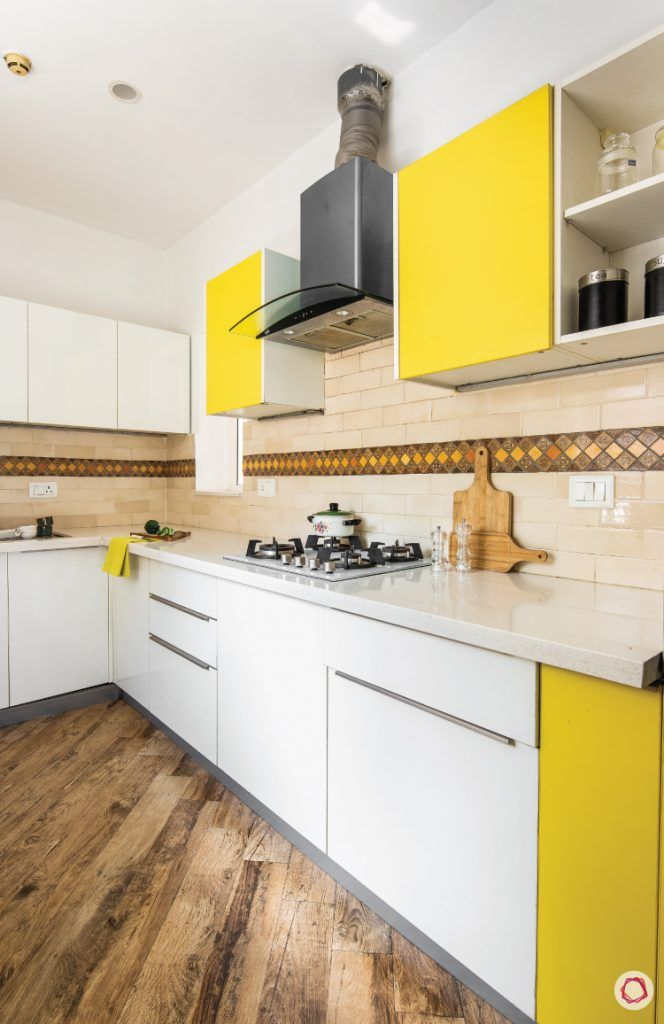 flat-in-faridabad-kitchen-yellow-white-cabients-flooring-wooden-chimney-groove-handle