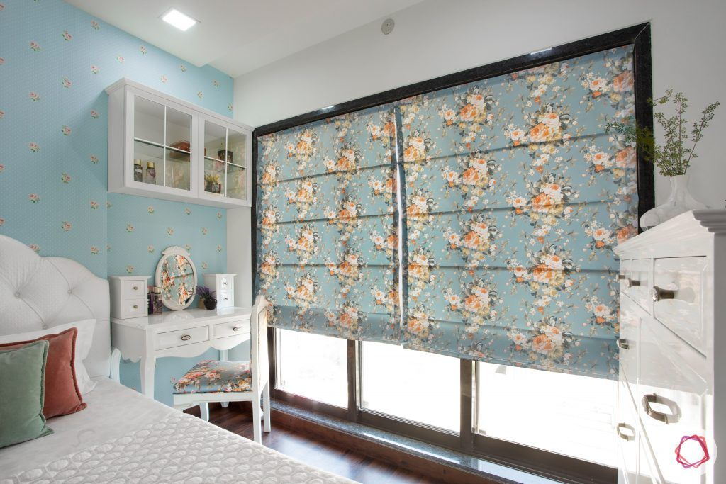 blinds-floral-bedroom-blue-wall-white-headboard-study-table-chair