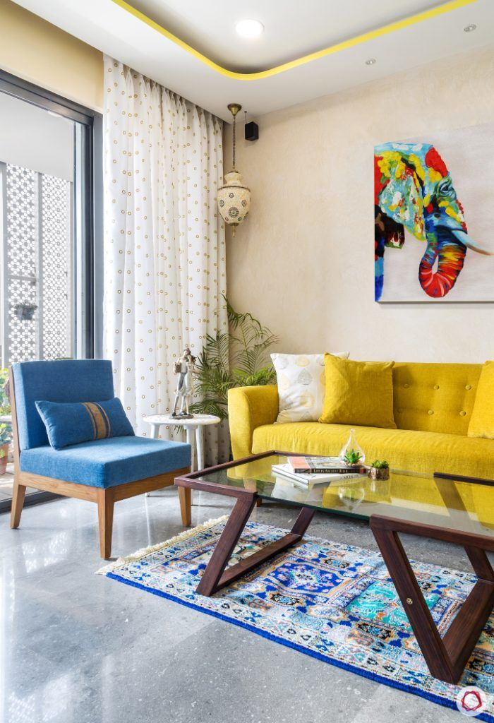 living-room-yellow-sofa-blue-chair-accent-light-stucco-paint