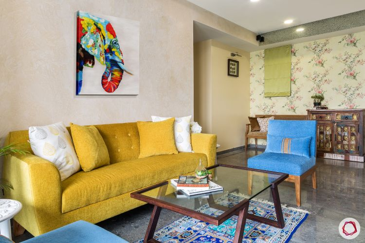 living-room-dining-sofa-yellow-blue-chair-wall-art-table