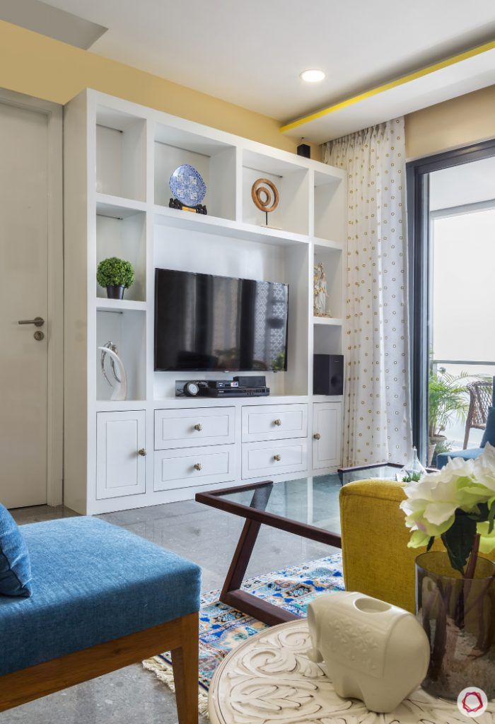 living-room-white-TV-unit-glass-table-blue-chair-balcony