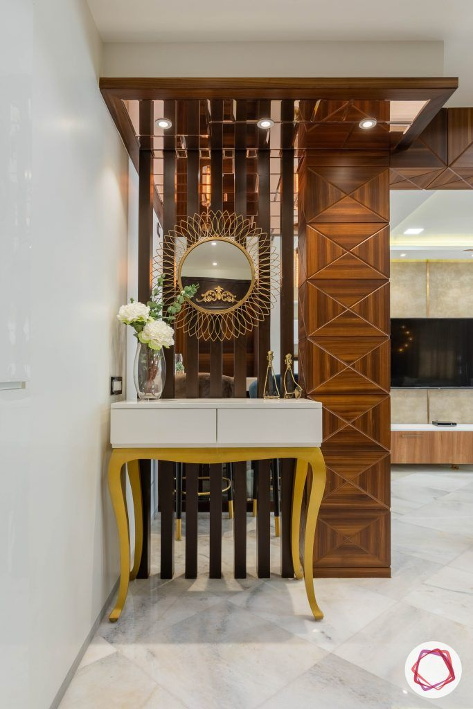 residential-interior-designers-in-mumbai-foyer-wood-gold-console-table