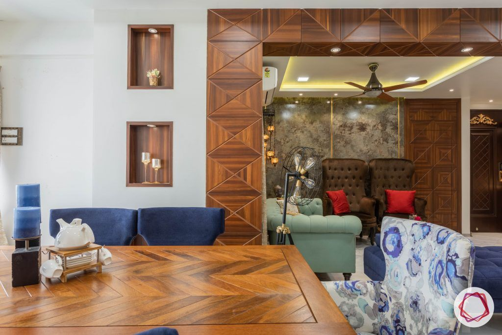 residential-interior-designers-in-mumbai-wooden-table-blue-chair-floral-candles