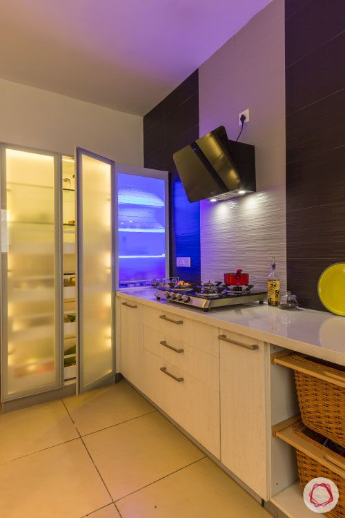 small kitchen design-frosted glass cabinets-light inside cabinets-tall unit