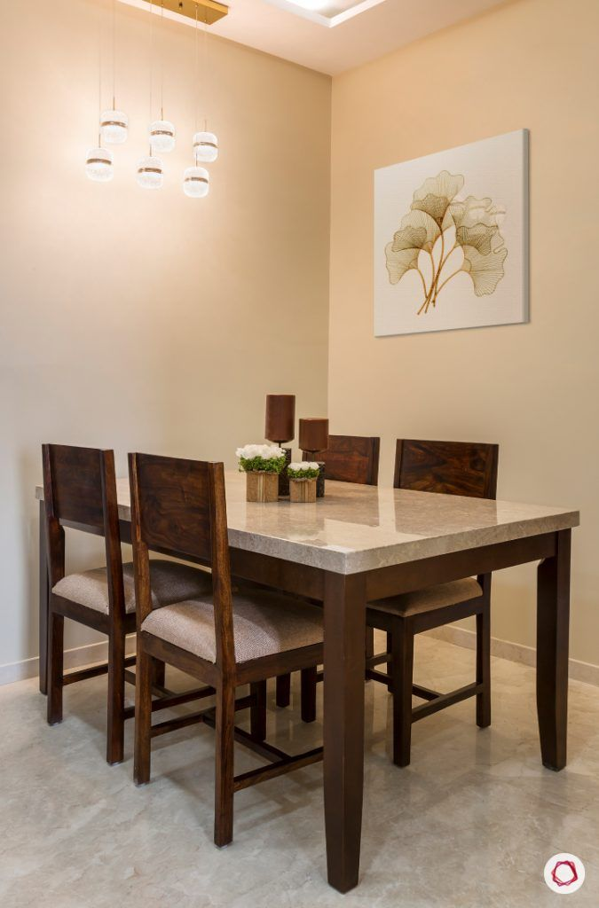 best interior designers in mumbai-dining room-marble top table-wooden chairs