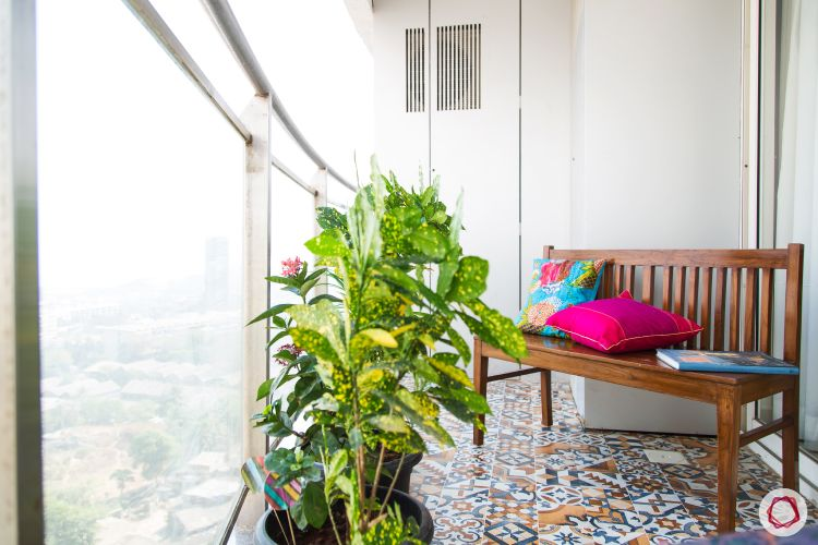 balcony-floor-wooden-bench-pink-cushion-plant-patterned