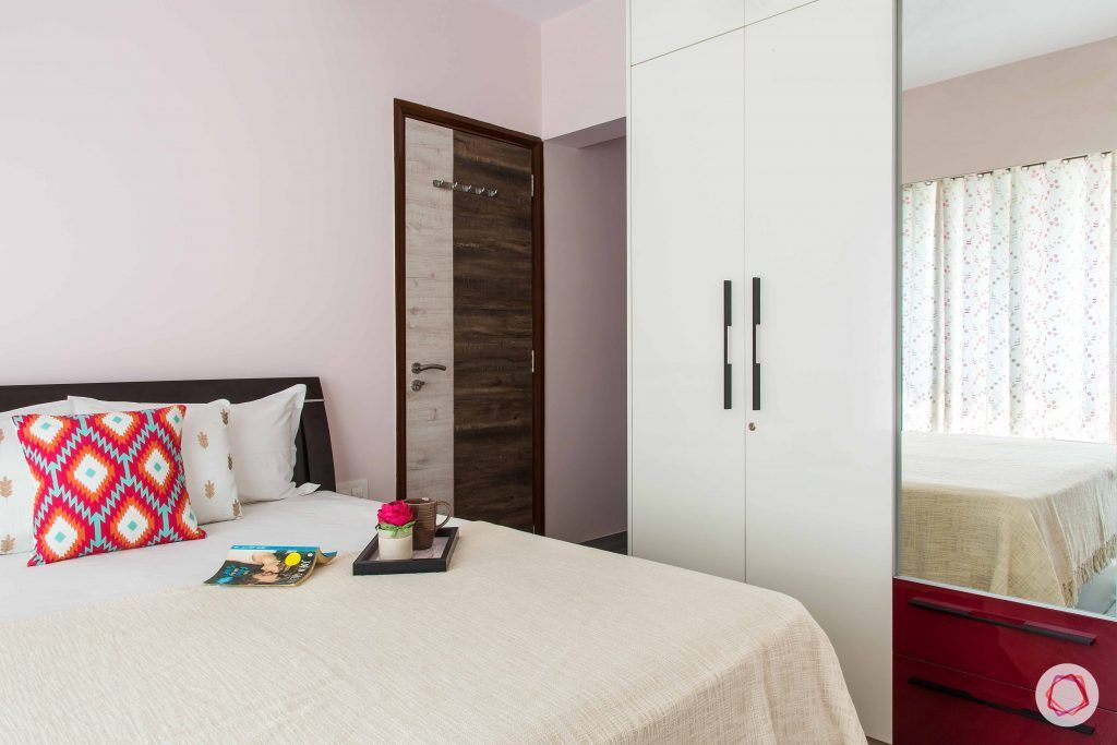pink-white-bed-red-pillow-curtain-white-wardrobe
